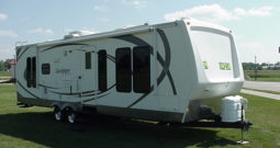 2009 SandPiper 29RL * Dry Weight 7125 Lbs. * Large Sofa/Dinette Slide * Queen Bed * High Gloss Gel Coat Exterior *